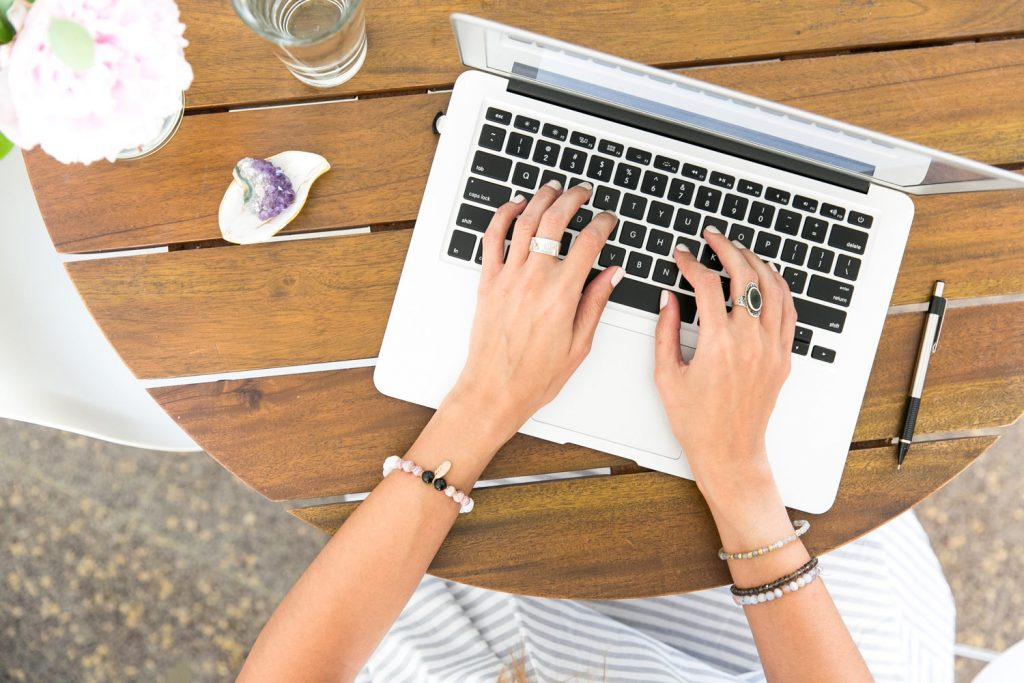 Woman creating her branding and writing content on computer