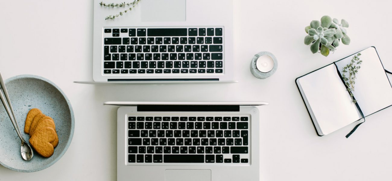 two laptops facing each other on a table